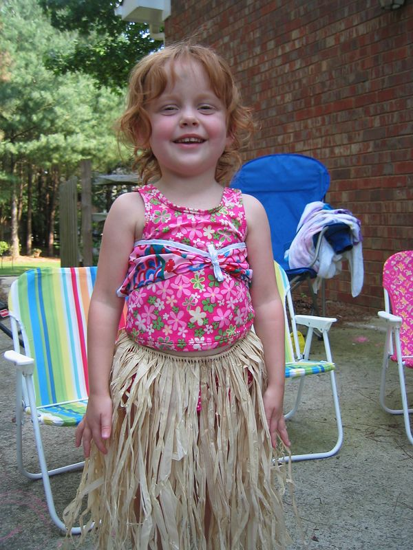 """Elizabeth LOVES her grass skirt from Granddad and Nana!  She kept saying """"This is so great!"""""""