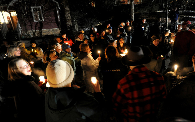 "About 200 people gathered with candles, spoke and sang songs th celebrate the life of the fallen elk.<br /> Jim Riemersma was among Mapleton Hill residents holding a candlelight vigil Sunday evening, celebrating the life of the fallen elk.<br /> For a video of the vigil, go to  <a href=""http://www.dailycamera.com"">http://www.dailycamera.com</a>.<br /> Cliff Grassmick  / January 6, 2013"