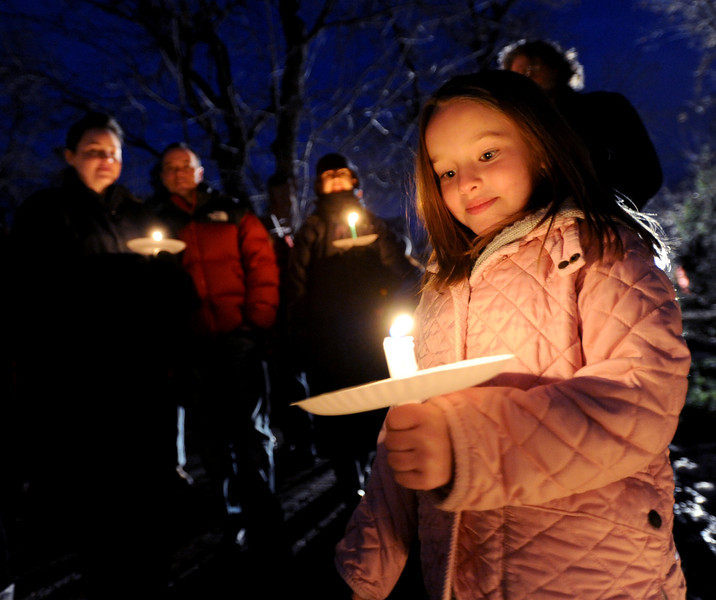 "isabelle Mazal, 6, was  among about 200 people that gathered to remember the elk.<br /> Jim Riemersma was among Mapleton Hill residents holding a candlelight vigil Sunday evening, celebrating the life of the fallen elk.<br /> For a video and more photos of the vigil, go to  <a href=""http://www.dailycamera.com"">http://www.dailycamera.com</a>.<br /> Cliff Grassmick  / January 6, 2013"