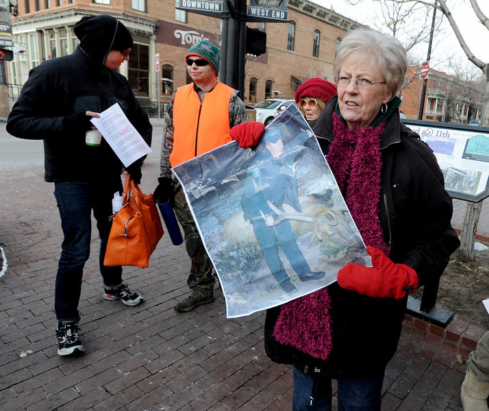 "Rita Anderson holds an enlargement of the elk and Boulder police officer she plans on taking on the march.<br /> A group of Boulder residents is organized a ""silent"" walk on the Pearl Street Mall on Sunday to honor the elk shot in the Mapleton Hill neighborhood on New Year's Day.<br /> For a video and more photos of the march, go to  <a href=""http://www.dailycamera.com"">http://www.dailycamera.com</a>.<br /> <br /> Cliff Grassmick  / January 13, 2013"