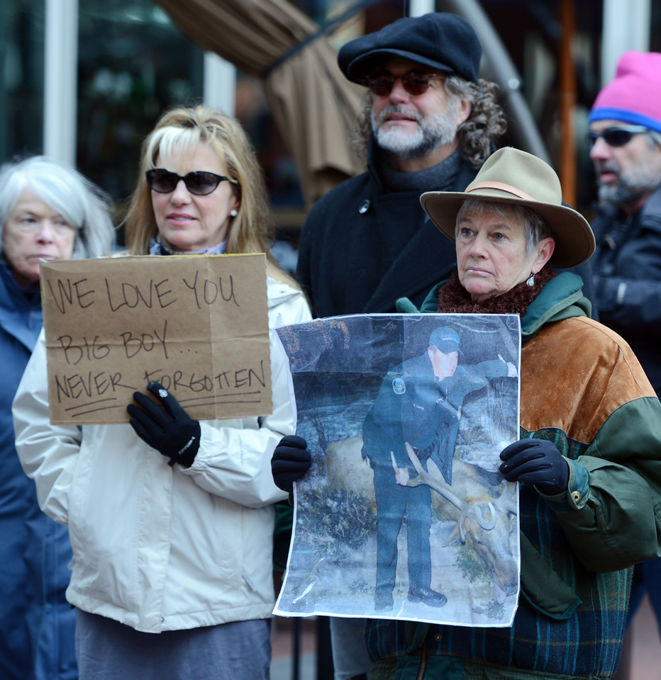 "Brenda Love Bennett, left, Gwen Dooley, and Jonathan Bennett, back, listen to speakers after the silent march.<br /> A group of Boulder residents is organized a ""silent"" walk on the Pearl Street Mall on Sunday to honor the elk shot in the Mapleton Hill neighborhood on New Year's Day.<br /> For a video and more photos of the march, go to  <a href=""http://www.dailycamera.com"">http://www.dailycamera.com</a>.<br /> <br /> Cliff Grassmick  / January 13, 2013"