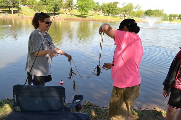 Tristen Weaver (left) gets some help from his mother, Toye, in his bid to earn the prize for smallest fish caught.