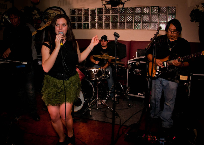 Amy performing with her band, the Amy Faithe Band.