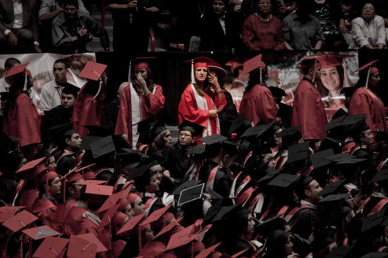 My UNM cherry and silver inspired photo of emily on her way to get her diploma.