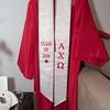 Emily's graduation gown.