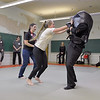 Ashleigh Fox | The Sheridan Press<br /> Tazmyn Olson attacks an Empower Wyoming instructor during the women's self defense class Dec. 27, 2017. Empower instructor Stormy Broad guided participants through the drills.