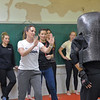 Ashleigh Fox | The Sheridan Press<br /> Kristi Olson holds the defensive stance during the women's self defense class Dec. 27, 2017 while Empower instructor Stormy Broad guides her through the physical defense drill.