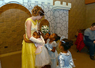 Erica Benson—ebenson@shawmedia.com  Caitlin Carr of Downers Grove receives attention from (left-right) Jania Clinton Ariana Tipton, Anaia Tipton, and Imarie Romero of Woodridge while she portrays Belle during the Enchanted Ball held at the Woodridge Park District Friday Feb. 8 2013.