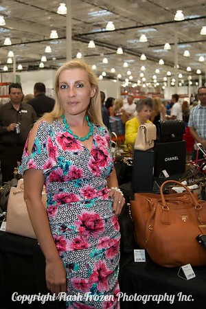 Sarah Horvet of Galpin Motors checking out the designer leather goods.