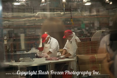 Meatcutters preparing their cuts for packaging.