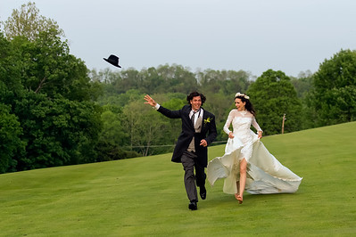 Wedding Shoot Out: Models Lynette and Steve - running away...My hat ...my hat :)