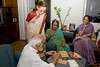 Dilipbhai preparing to write while Urvashi, Kirti & Priti look on