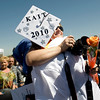 Kelly Paine, of Erie, gets a rose and a hug from her graduating daughter, Kaitlyn Paine, 17, at the Erie High School graduation in Erie, Saturday, May 29, 2010. <br /> <br /> Kasia Broussalian