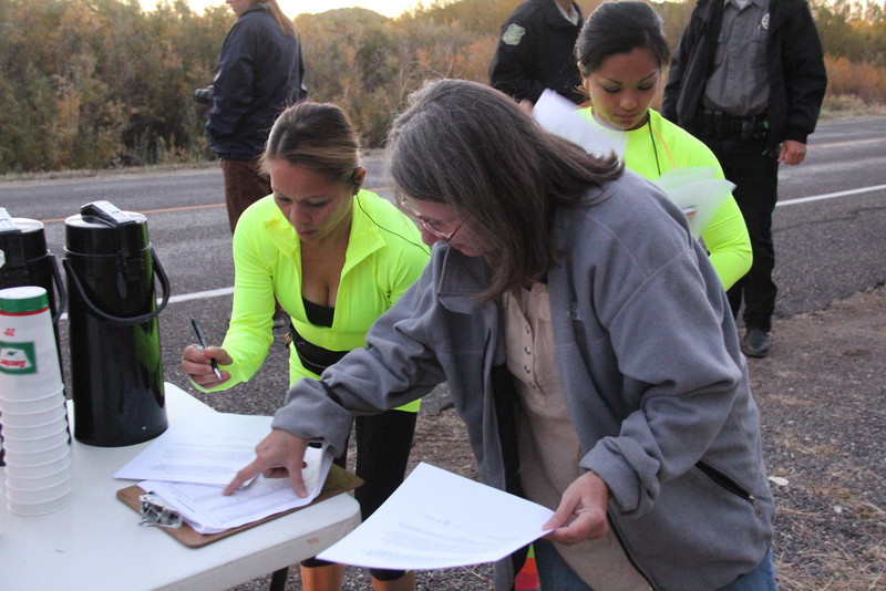 Mary Parkin getting the last of the paperwork done. Lets get this thing STARTED!!!<br /> Escalante Canyons Marathon<br /> The beautiful Sunrise start of our Marathon made for some great Imagery and Amazing views for our runners.