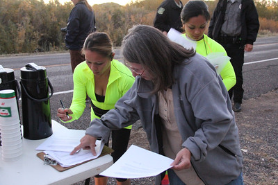 Mary Parkin getting the last of the paperwork done. Lets get this thing STARTED!!! Escalante Canyons Marathon The beautiful Sunrise start of our Marathon made for some great Imagery and Amazing views for our runners.