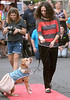 Kara Chrin, owner of Pawfectly Adorable custom designed pet accessories, leads Nena, from Pibbles & More Animal Rescue, along the red carpet at the Essence of Ambler Fashion Show Friday, Sept 5, 2014. <br /> Montgomery Media staff photo by Bob Raines