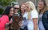 Lauren Keleher Lashinger, second from left, owner of Stella & Dot, shows her iPad photos to models, from left, Cynthia Perl, Niki Bean, Dana Hahn and Robin Helzerman at the Essence of Ambler Fashion Show Friday, Sept 5, 2014. <br /> Montgomery Media staff photo by Bob Raines