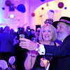 Walt Hester | Trail Gazette<br /> Debbie Burg and Dennis Murphy of Dillon, Colo. photograph themselves at the Stanley Hotel's New Year's Eve celebration in their Concert Hall. More than 125 people rang in 2012 at the event.