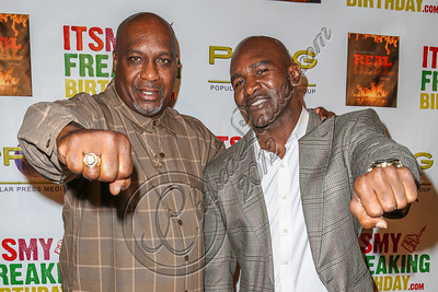 HOLLYWOOD, CA - OCTOBER 19:  Boxers Henry Tillman (L) and Evander Holyfield arrive at the after party for Evander Holyfield's 50th birthday celebration on October 19, 2012 in Hollywood, California.  (Photo by Chelsea Lauren/WireImage)