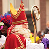 """Typical Dutch happening for little children: the arrival of Sinterklaas in Holland. The story of Sinterklaas is that he is an 200 years old man that lives in Spain. He comes to Holland every year in November. He is not alone, he has helpers called """"Zwarte Pieten"""". Zwarte Pieten are doing funny things give """"strooigoed"""" (special candy) and climb on the roofs of houses to bring presents through the chimney. The story is that they only do that to those children that sing special Sinterklaas-songs at the chimney just before they go to bed. After the singing they can put a shoe near the chimney and hopefully Sinterklaas and Zwarte Piet bring something during the night. Those little presents are most of the time special Sinterklaas candy. Sometimes children get a winter carrot from their parents in order to put that in their shoe for the white horse of Sinterklaas. The children never see the connection with the food they get the next day: always something with winter carrots. This period ends as Sinterklaas celebrates his birthday on the 5the of december and then he gives bigger presents (although I always see parents and grandparents buying those gifts ;-). More photo's in this gallery: <a href=""""http://wilmabosma.smugmug.com/Events/Sinterklaas-2011/20041026_kQtTV3#1580111594_nJQfSRT"""">http://wilmabosma.smugmug.com/Events/Sinterklaas-2011/20041026_kQtTV3#1580111594_nJQfSRT</a>"""