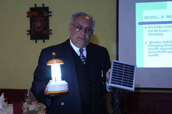 Mr. Prakash Jiwan Sondhi explains how solar lanterns work at a fund raiser dinner to support distribution of solar lanterns in Chitrakoot, India.