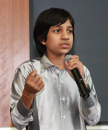 "Master Kishan of Bangalore, India, speaking at the India Development Service 2009 Symposium at Loyola University Medical School, Maywood,(Chicago) IL at age 14 in 2009 about his film, ""Care of Footpath'"" Master Kishan is listed in the Guinness Book of Wolrd Records as the Youngest Movie Producer on earth."
