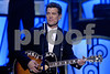 """The multitalented Chris Isaak sings his own stylish redention of a song made famous by the legendary Smokey Robinson entitled """"My Girl"""" at the United Negro College Funds """"An Evening of Stars"""" tribute to Smokey Robinson on Saturday, September 22, 2007 in Pasadena, California.<br /> (AP Photo/Earl Gibson III)"""