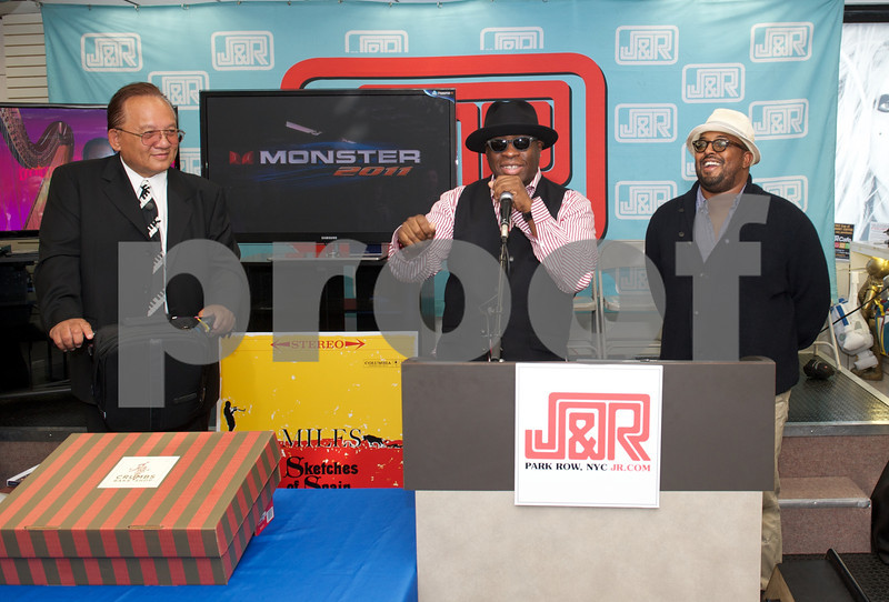 (L-R) Noel Lee (CEO of Monster Cable) Vince Wilburn (Nephew of Miles Davis) and Erin Davis (Son of Miles Davis) celebrate his 85th Birthday at a meet and greet at J&R Music on Thursday May 26, 2011 in New York, NY<br /> (AP Photo/Earl Gibson III)