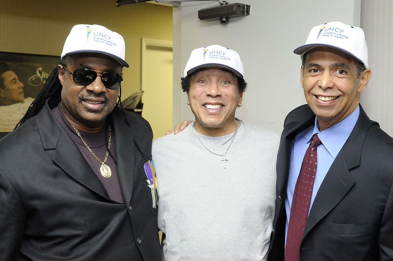 "Stevie Wonder along with Smokey Robinson and Dr. Michael L. Lomax (President of the United Negro College Fund) embrace the future of the UNCF as they promote ""An Evening of Stars"" This years celebration will  honor Smokey Robinson.  Jan. 24, 2008 Los Angeles, CA<br /> (AP Photo/Earl Gibson III)"