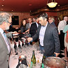 Doug Fabbolii, Fabbioli Cellars, pours a sample for Frank Morgan of Virginia Beach