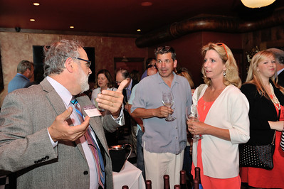 Doug Fabbioli (L) talks wine with Scott and  Lynn Johnson of Ashburn