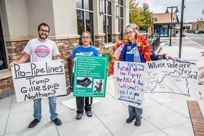 350 Loudoun members Lee Stewart (L) and Maria Bergheim (C) protest outside Eddie Merlot's prior to the gubenatorial debate.