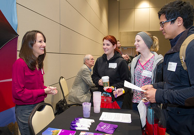 Student Rudy Lozano(right) , Megahan Thorndyke and Katelyn Redding receive information at the intenship and part-time job fair.