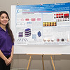 Student Mariela Vazquez stands with her project for the Trio McNair Scholar Poster Presentation.