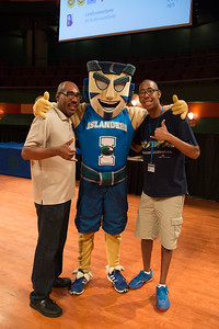 Students Josiah Wray and his father David Wray pose for a picture with Izzy before the new student orientation start.