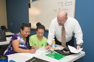 Jeannie Hernandez(left) and Amy Hernandez are assisted by Scott Kruse of the College of Business in TAMU-CC at the Financial Literacy class held in Coastal Compass.