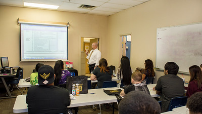 Scott Kruse from the TAMU-CC College of Business presents a breakdown of the 1040 document to attendees at the Financial Literacy class held at Coastal Compass.