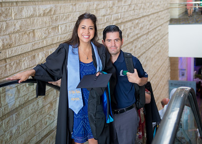 Arlene Nedrano and Christopher Nedrano make their way to the graduate's waiting area. Saturday August 8 at the TAMU-CC Summer Commencement ceremony.