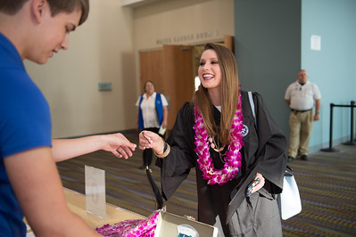 Torin Havelka(left) gives Keli Chancellor her 2015 tassel. Saturday August 8, 2015 at the TAMU-CC Summer Commencement ceremony.