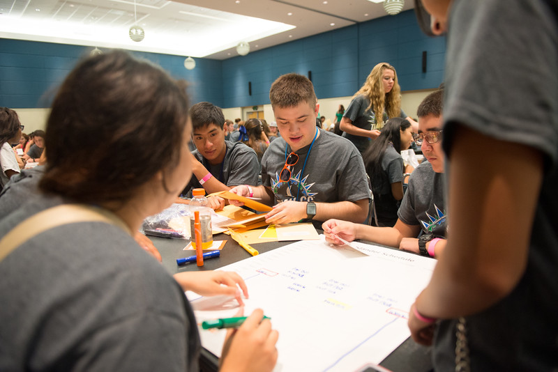 Orientation attendee William Gilmore, assists his group with making a time table during the Islander Challenge in the Univeristy Center.