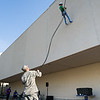 Emma Witworth practices proper postioning techniques for repelling during the ROTC repell drill
