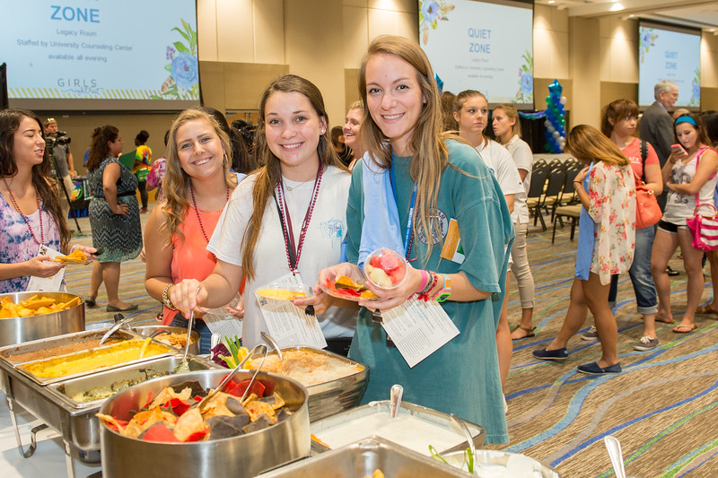 Mary Edwards(left) Hailey Anderson and Reagan Bego pick up some food at the TAMU-CC Girls Night Out event, on Tuesday September 1, 2015. Over 500 students attended the event welcoming them into college.