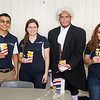 Benjamin Franklin (Victor Hinojosa) and GSA students Richard Torres, (from left) Avery Pantoja and Carolina Ouvares hand out Constitutioin booklets near the library to students for Constitution week