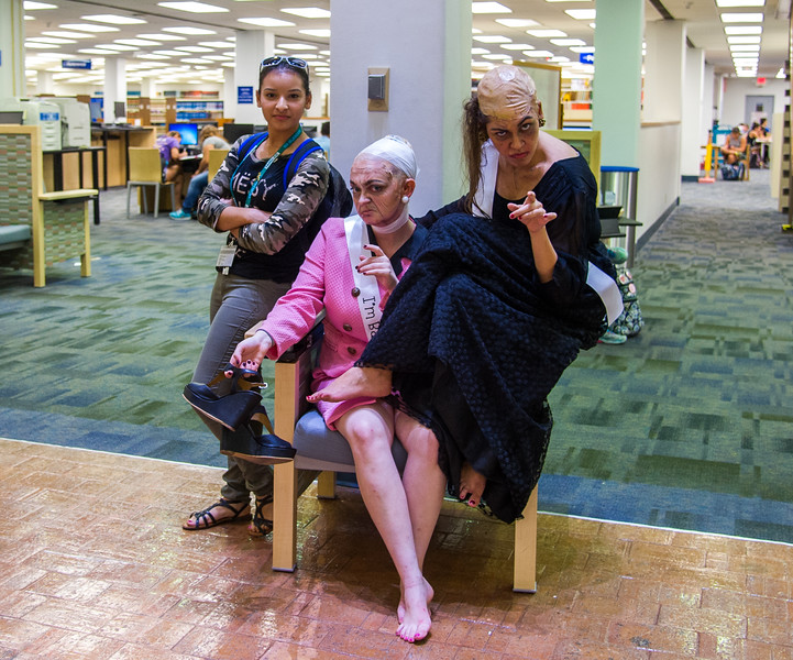 Student Victoria Vasquez(left) poses with Malena Collom and Lauren Champion, who are dressed as witches for Banned Books Week.