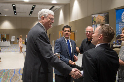 TAMU-CC President Flavius Killebrew greets panelist Toby Baker at the Texas Tribune event. Monday September 28, 2015 at TAMU-CC.