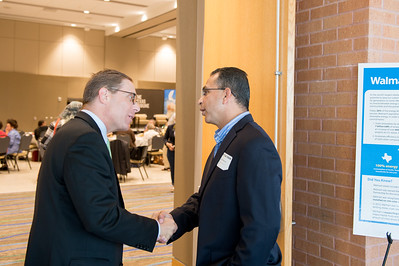 Evan Smith greets Abel Herrero as he enters the Texas Tribune event. Monday September 28, 2015 at TAMU-CC.