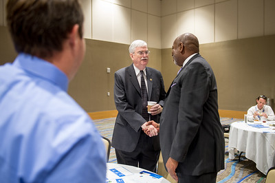 TAMU-CC President Flavius Killebrew greets panelist John Hall at the Texas Tribune event. Monday September 28, 2015 at TAMU-CC.