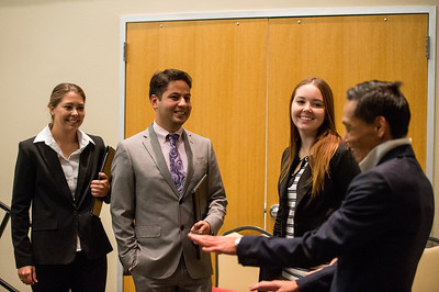 Jaime Jackson(left) Orlando Narvaez and Amber Otholt speak to Dr. Jim Lee behind the scenes at the Get the Job Career Fair.