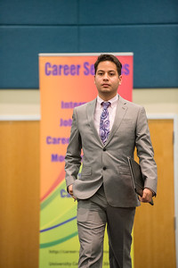 Orlando Narvaez models clothing suggested to wear at a job interview during the Get the Job Career Fair at TAMU-CC. Thursday October 01, 2015.