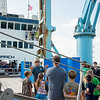 Mark Bowden the Ocearch vessel's engineer. Informs touring families on how the crane operates when moving a hooked shark for research. Monday October 12, 2015.